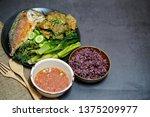Stock photo fried mackerel with shrimp paste sauce with rice berries nam prik kapi pla too 1375209977