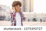 smiling afro american girl in... | Shutterstock . vector #1375393727