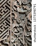 Small photo of Traditional Balinese carving with swastika