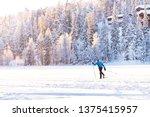 A Man Slides On Skis On A Snow...