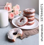 homemade donuts with white... | Shutterstock . vector #1375444571