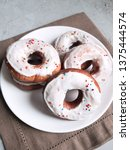 donuts with white icing on the... | Shutterstock . vector #1375444574
