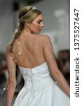 Small photo of NEW YORK, NY - APRIL 11: A model walks the runway during the Morilee by Madeline Gardner Spring 2020 bridal fashion show at New York Fashion Week: Bridal on April 11, 2019 in NYC.