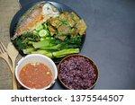 Stock photo fried mackerel with shrimp paste sauce with rice berries nam prik kapi pla too 1375544507