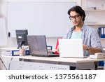 it specialist working in the... | Shutterstock . vector #1375561187