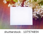 paper card in cherry blossom   Shutterstock . vector #137574854