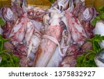 squid fishes on fish market... | Shutterstock . vector #1375832927