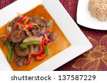 A beautifully presented dish of spicy eggplant with beef and mixed vegetables beef and brown rice. - stock photo