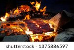 sausages on camping barbecue... | Shutterstock . vector #1375886597