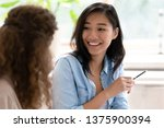 asian student girl looking at...   Shutterstock . vector #1375900394