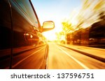 a car driving on a motorway at... | Shutterstock . vector #137596751
