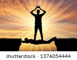 selfish man puts a crown on his ... | Shutterstock . vector #1376054444