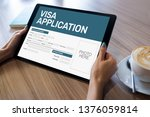 Small photo of Online Visa application form on screen. Country Visit permit.