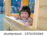asian baby girl playing on... | Shutterstock . vector #1376101064