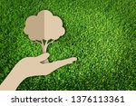 saving tree. paper cut of eco... | Shutterstock . vector #1376113361