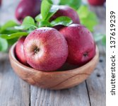 sweet red apple on the wooden... | Shutterstock . vector #137619239