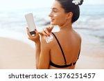 woman apply sun cream...   Shutterstock . vector #1376251457