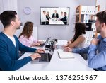 rear view of businesspeople... | Shutterstock . vector #1376251967