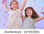studio portrait of two joyful... | Shutterstock . vector #137641001