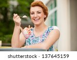 attractive young woman eats ice ... | Shutterstock . vector #137645159