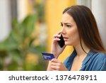 worried online buyer talking on ...   Shutterstock . vector #1376478911