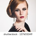young woman portrait in studio   Shutterstock . vector #137653349