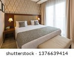 Stock photo interior of a luxury double bed hotel bedroom 1376639414