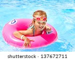 Children Sitting On Inflatable...
