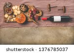wine and snack set. flat lay of ... | Shutterstock . vector #1376785037