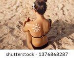 woman applying sun cream creme...   Shutterstock . vector #1376868287