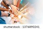 diverse creative team stacking... | Shutterstock . vector #1376890241