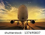 airplane at sunset   back lit   Shutterstock . vector #137690837