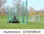 Worker On A Large Green Lawn...