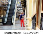 little girl walking in shopping ... | Shutterstock . vector #137699924