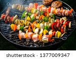 barbecue  cooking shish kebabs... | Shutterstock . vector #1377009347