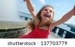 happy  girl's face spinning by... | Shutterstock . vector #137703779