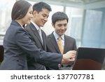 three business people looking... | Shutterstock . vector #137707781