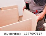 Stock photo handyman service in the process of assembling furniture assembly kitchen closets and cabinets from 1377097817