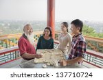 Chinese Family Playing Chinese...