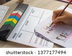 Small photo of Storyboard drawing with pencil creative sketch cartoon. Storyboarding is process image displayed in sequence for purpose of pre-visualizing motion picture, interactive media. Concept sketching ideas.