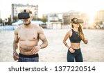 young couple running at beach... | Shutterstock . vector #1377220514