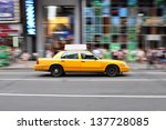 Panning Shot Of A Taxicab At...