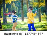 happy two brother kids playing... | Shutterstock . vector #1377494597