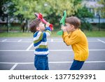 happy two brother kids playing... | Shutterstock . vector #1377529391