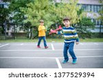 happy two brother kids playing... | Shutterstock . vector #1377529394