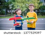 happy two brother kids playing... | Shutterstock . vector #1377529397