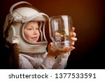 child in an astronaut helmet.... | Shutterstock . vector #1377533591