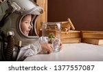 child in an astronaut helmet.... | Shutterstock . vector #1377557087