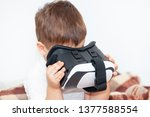 little boy with virtual reality ... | Shutterstock . vector #1377588554