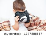 little boy with virtual reality ... | Shutterstock . vector #1377588557